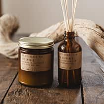 Black Fig soy wax candle & scented oil reed diffuser combo, presented in apothecary inspired amber jars. By P.F. Candle Co.