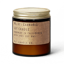 Cannabis scented soy wax candle hand-poured into an apothecary inspired amber jar. By P.F. Candle Co.