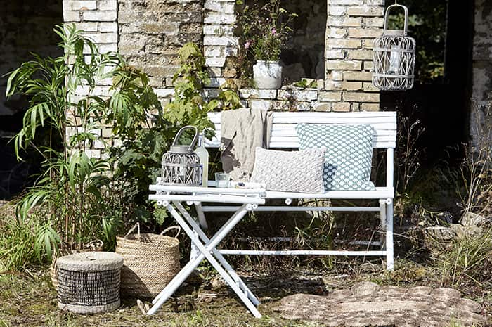 Lene Bjerre handmade bamboo furniture for use indoors & outdoors, pictured here is the white bench and table.