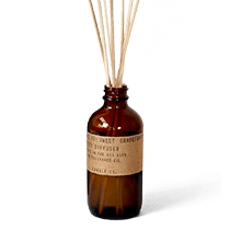 Sweet Grapefruit scented oil reed diffuser, presented in an apothecary inspired amber jar, with natural rattan reeds. By P.F. Candle Co.