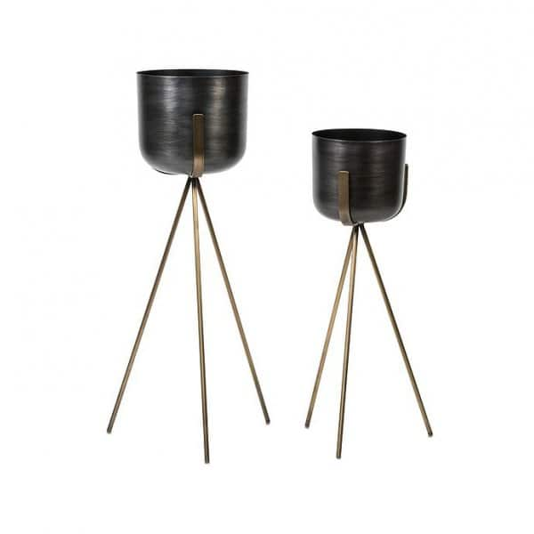 Antique Brass Pot on a tripod stand, hand-crafted from Iron, containing a Citronella candle. By Dekocandle of Belgium