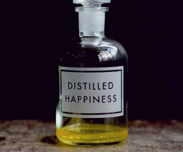 Apothecary Bottle etched with 'Distilled Happiness', with air-tight seal, perfect for liquid storage. By Vinegar & Brown Paper