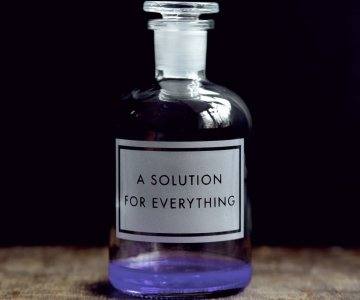 Apothecary Bottle etched with 'Solution For Everything', with air-tight seal, perfect for liquid storage. By Vinegar & Brown Paper