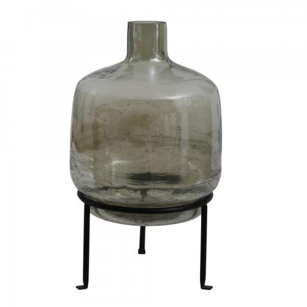 'Cate' Green Glass Vase / Bottle, presented on an Iron stand. By PTMD Collection®