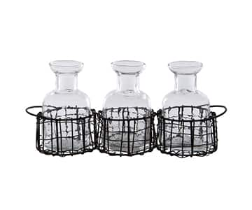 Clear Glass Bottles (set of 3) presented in a Black Wire Basket. By British brand, London Ornaments