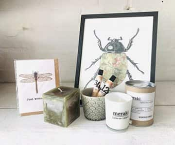 Gift Set suggestion 7 - Includes a framed Vanilla Fly print, a cube candle, a Meraki scented candle, a ceramic pot, hand cream and a card of your choice