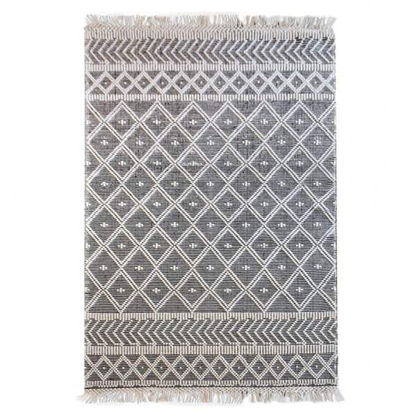 'Ogun' Rug, made from 70% Wool / 30% Cotton, with fringes, and presented in Black / White. By The Rug Republic