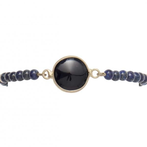 'Roux' elastic Bracelet, in Blue and with 14 carat Gold plating, with a Blue stone. Bohème Chic style by Dansk Copenhagen